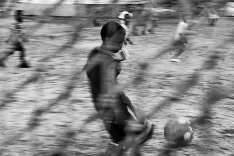 Children playing football on a community field, Mitchell's Plain, 2011.