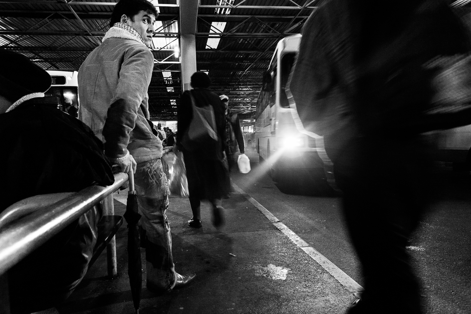 A commuter is waiting on the bus, Cape Town, 2010.