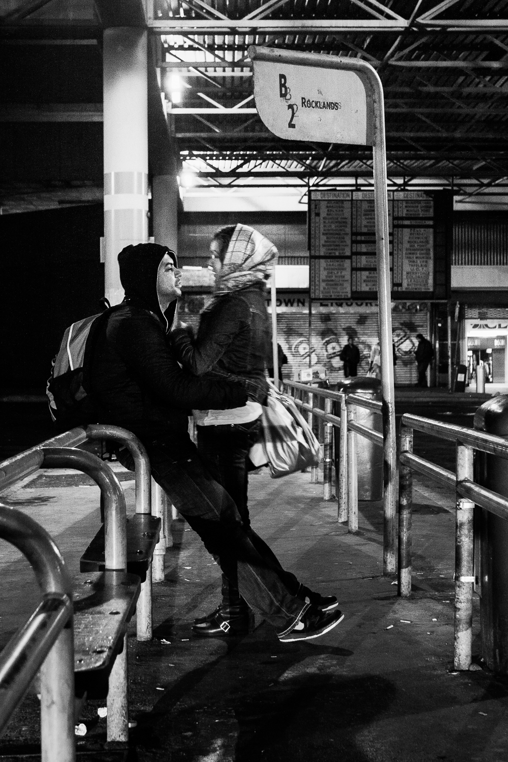 A young couple waiting for the bus to Rocklands, Cape Town, 2009.