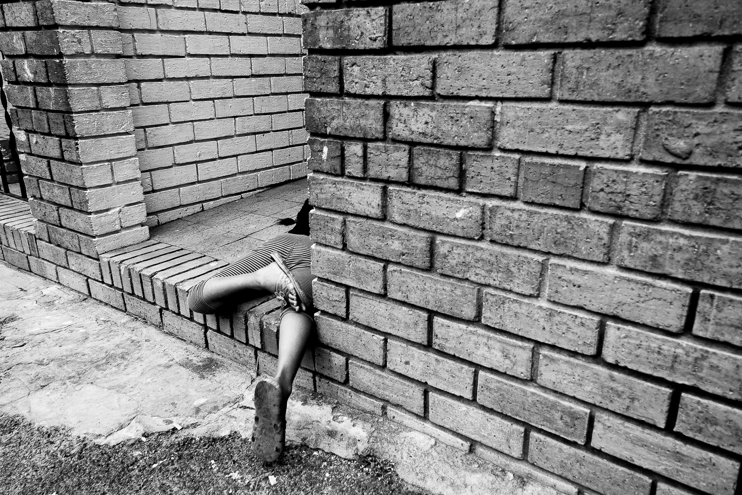 Child playing in the front yard of her home, Salt River, 2011.